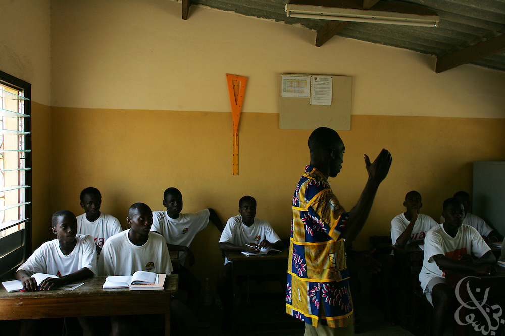 Teenage Ivorian football players attend their afternoon academic classes at the ASEC football academy February 16, 2006 in Abidjan, Côte d'Ivoire. ASEC academy has an established history of producing top notch footballers who go on to play in the top European football leagues. The directors of ASEC stress the importance of education to their players and insist on a balanced regimen of education and football.