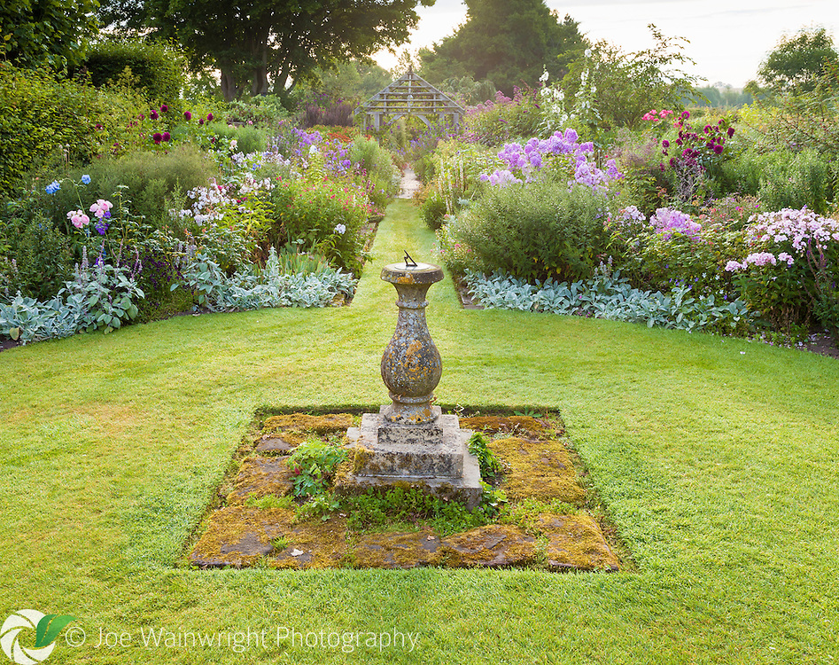 The Sundial Garden at Wollerton Old Hall Garden, Shropshire, photographed early in the morning, in July