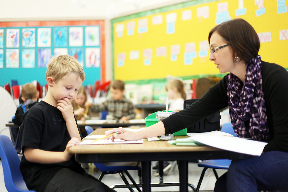 Nancy Vezinet gives Kaleb Van Horn an assessment. Casey Brennan's kindergarten class at Hopkins Elementary School in Sherwood on Wednesday, May 23, 2012.