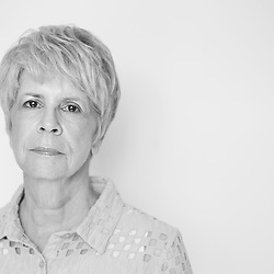 Black and white portrait photograph of sad and upset senior woman