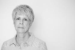 Black and white portrait photograph of sad and upset senior woman