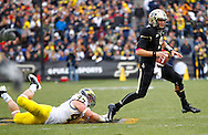 WEST LAFAYETTE, IN - OCTOBER 06: Quarterback Robert Marve #9 of the Purdue Boilermakers escapes the tackle of linebacker Jake Ryan #47 of the Michigan Wolverines at Ross-Ade Stadium on October 6, 2012 in West Lafayette, Indiana. (Photo by Michael Hickey/Getty Images) *** Local Caption *** Robert Marve; Jake Ryan