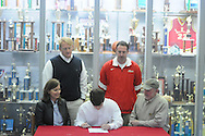 Lafayette High baseball player Luke Stanley signs to play baseball for Northeast Community College, in Oxford, Miss. on Thursday, January 26, 2012.