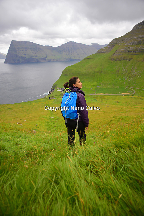 Young active woman hiking in Kalsoy, Faroe Islands