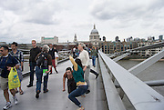 23/07/2012. London, UK. The Bridge 2012, is an interactive performance on the Millennium Bridge, London, conceived by Janine Harrington. Through a series of encounters, the work invites passersby to explore their relationships to the performers - as audience, and as collaborators.