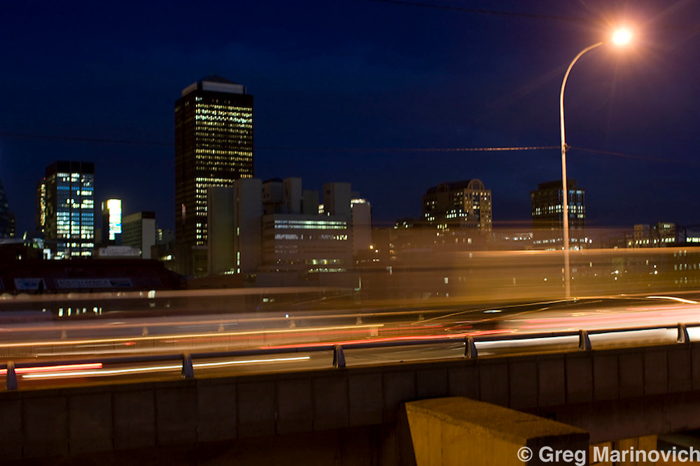 Johannesburg, South Africa Nov 5, 2007: Downtown Johannesburg is all lit up as rush hour traffic heads south to Soweto on the M2 motorway, Nov 5, 2007. South Africa's power needs have increased 50% since 1994, without an increase in capacity, leading to rolling blackoputs. Photo Greg Marinovich / Bloomberg News