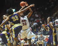 "Ole Miss guard Zach Graham (32) is fouled by Alcorn State's Michael Martin (33) at the C.M. ""Tad"" Smith Coliseum in Oxford, Miss. on Thursday, December 29, 2010. (AP Photo/Oxford Eagle, Bruce Newman)"