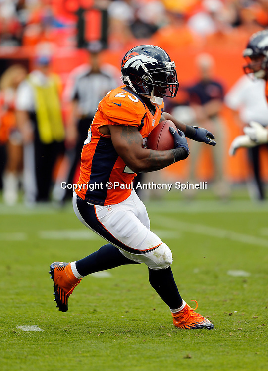 Denver Broncos running back Willis McGahee (23) runs the ball during the NFL week 4 football game against the Oakland Raiders on Sunday, Sept. 30, 2012 in Denver. The Broncos won the game 37-6. ©Paul Anthony Spinelli
