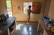 Woman in kitchen near Belic, Granma, Cuba.