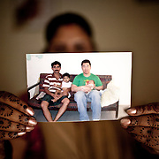 Surrogate mother for first western couple, Rabina Mondal (31) shows the file photograph of Thomas Kim with his son Brady who the first baby to a western couple delivered on February 2nd 2007 at the Akanksha Infertility Centre & IVF Centre in Anand, Gujarat, India. Rabina  now mentors surrogate mothers and houses women throughout their pregnancy.