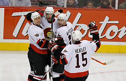 April 26, 2007; East Rutherford, NJ, USA; The Ottawa Senators celebrate a goal by Ottawa Senators defenseman Joe Corvo (7) during the first period at Continental Airlines Arena in East Rutherford, NJ.