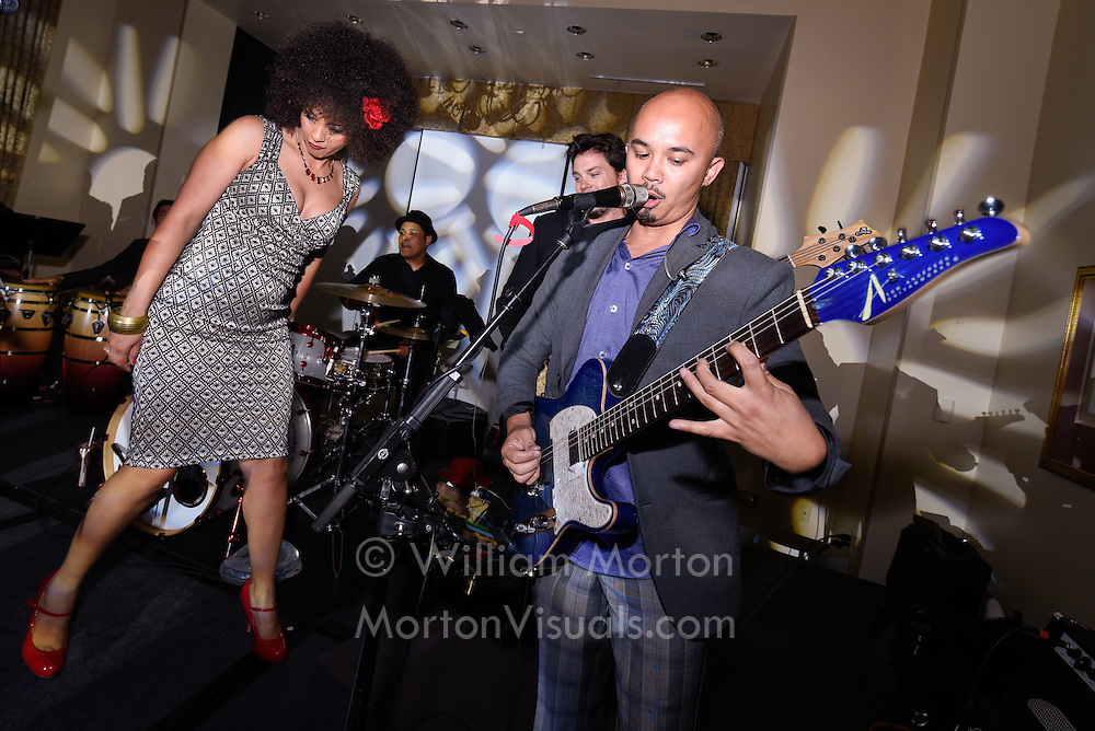A live band plays a concert for conference guests in San Diego. Photography by Dallas event photographer William Morton of Morton Visuals event photography.