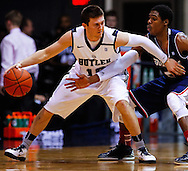 INDIANAPOLIS, IN - FEBRUARY 19: Rotnei Clarke #15 of the Butler Bulldogs tries to hold off Jerry Jones #5 of the Duquesne Dukes at Hinkle Fieldhouse on February 19, 2013 in Indianapolis, Indiana. Butler defeated Duquesne 68-49. (Photo by Michael Hickey/Getty Images) *** Local Caption *** Rotnei Clarke; Jerry Jones