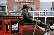 Stagecoach master waiting for passengers. Jackson Hole, Wyoming.
