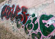 Urban Artwork, Grafitti, on a pink retaining wall in Urban Atlanta.