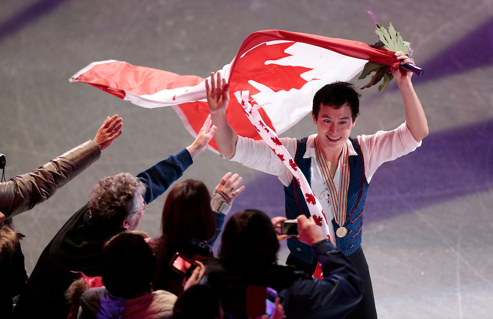 -20130315- London, Ontario,Canada--  <br /> Gold medalist Patrick Chan of Canada does a victory lap following the mens competition at the 2013 World Figure Skating Championships in London, Ontario, March 15, 2013. <br /> AFP PHOTO/Geoff Robins