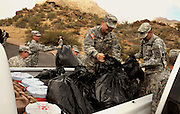 """Members of the U S. Army National Guard, Alpha Company, 1st Battalion, 158th Infantry Regiment, """"Bushmasters"""" clear trash from the Gates Pass Overlook, Tucson, Arizona, USA.  Every December the guardsmen perform an act of community service.  This year the guardsmen selected Gates Pass because of the Bushmasters WWI Memorial at the site."""