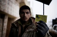 SYRIA - Al Qsair. A Syrian Army defectors, actually member of Free Syrian Army,shows his military ID on January 25, 2012. Al Qsair is a small town of 40000 inhabitants, located 25Km south-west of Homs. The town is besieged since the beginning of November and so far it counts 65 dead. ALESSIO ROMENZI