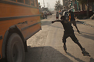 Port-au-Prince, Ouest, HAITI, 21/03/2011:  Haitian boys practicing inline skate in Port-au-Prince streets. (photo: Caio Guatelli)