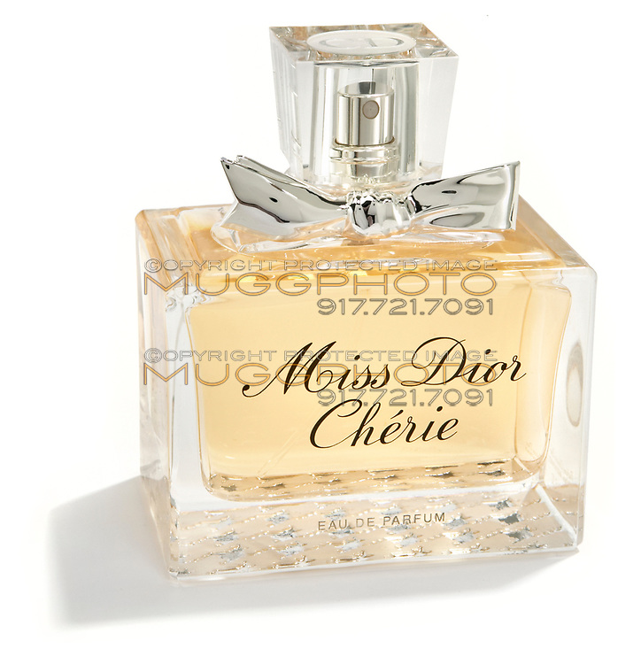 miss dior cherie parfum bottle with a silver bow
