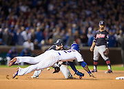 CHICAGO, IL - OCTOBER 30, 2016: Jason Heyward #22 of the Chicago Cubs steals second base against Jason Kipnis #22 of the Cleveland Indians during Game 5 of the 2016 World Series between the Cleveland Indians and the Chicago Cubs at Wrigley Field on October 30, 2016 in Chicago, Illinois. (Photo by Jean Fruth)