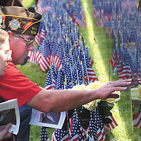 "Vietnam veteran Edmund Schwab, of Bowling Green, Ky., reaches out to touch the name of a fallen comrade at the ""Wall That Heals Vietnam Memorial"" display in Franklin, Ky. aekdb  ""Fallen Friends"""