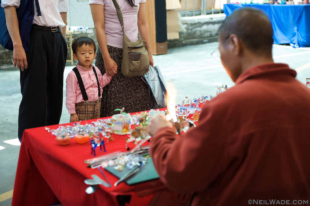 An Artist makes hand made glass figures at the Taipei Artists Market in Taipei, Taiwan.