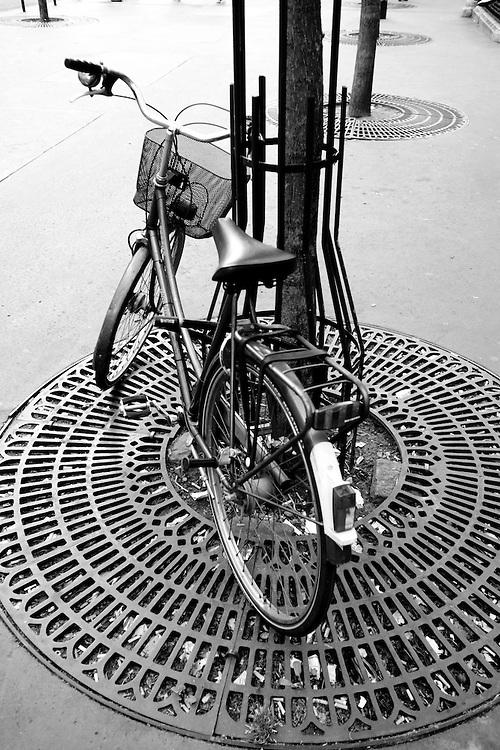 Black and white photo of bicycle  on Rue de Bonne-Nouvelle, Paris, France.
