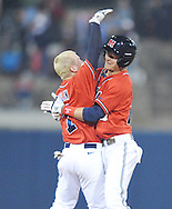 Mississippi's Brantley Bell, right, celebrates his game winning RBI single against Arkansas-Little Rock with teammate Dalton Dulin at Oxford-University Stadium in Oxford, Miss. on Friday, March 7, 2014. Mississippi won 2-1 in 10 innings. (AP Photo/Oxford Eagle, Bruce Newman)