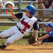 "Warren County Southern's number Kevin Belt avoids the tag of Butler County's Sam Sanspree as he slides safely into home Monday during the Little League playoffs in Franklin. aekdb ""Safe at Home"""