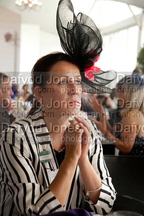 MRS. ROBERT PAIN, Fashion shows in the Besborough Restaurant during Ascot week. Ascot. Tuesday 16 June 2009.