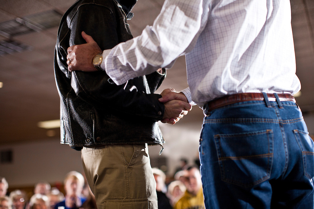 Republican presidential candidate Mitt Romney, right, shakes hands with Sen. John Thune (R-SD) at a campaign rally at the Mississippi Valley Fairgrounds on Monday, January 2, 2012 in Davenport, IA.