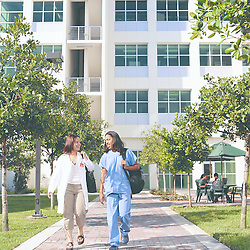 Two students leaving the University of Miami School of Nursing and Health Studies building.
