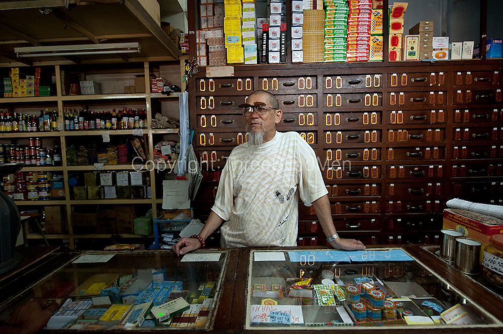 Pharmacist in an old traditional Chinese Pharmacy in Port Louis.