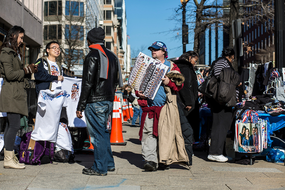 People hawk Inauguration souvenirs on the street near the White House on Sunday, January 20, 2013 in Washington, DC.