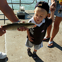 ANNA MARIA ISLAND, FL -- February 2, 2005 -- Holding the hand of his mother, Lenka, a curious Rico Eckert, 2, gets a close up look at a trout a fisherman caught while on his family's 5-week vacation from Germany on the pier at Manatee Public Beach on Anna Maria Island Thursday, February 3, 2005.