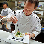 """SHOT 7/29/09 7:49:15 PM - TAG restaurant on Larimer Square in downtown Denver, Co. The restaurant operated by chef/owner Troy Guard features what they term """"continental social food"""" and features influences from numerous continents. Chef Troy Guard works his magic in the kitchen at TAG. (Photo by Marc Piscotty / © 2009)"""