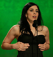 Master of Ceremonies Sarah Silverman adjusts her dress while hosting the 2006 Independant Spirit Awards in Santa Monica, California March 4, 2006.  REUTERS/Rick Wilking