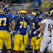 Delaware Offensive Tackle Erle Ladson #78 and the rest of the Delaware offensive line rest during a Week 1 NCAA football game against West Chester. ..#15 Delaware defeated Westchester 28-17 in their home opener at Delaware Stadium Saturday Aug. 30, 2012 in Newark Delaware...Delaware will return home Sept. 8, 2012 at 3:30pm for a showdown with interstate Rival Delaware State in the Route 1 Rivalry Bowl at Delaware Stadium.