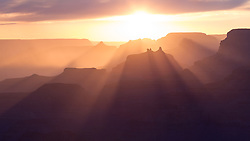 Rays of sunlight, known as Crespecular Rays, pass through the many temples and buttes of the Grand Canyon including Angels Gate.