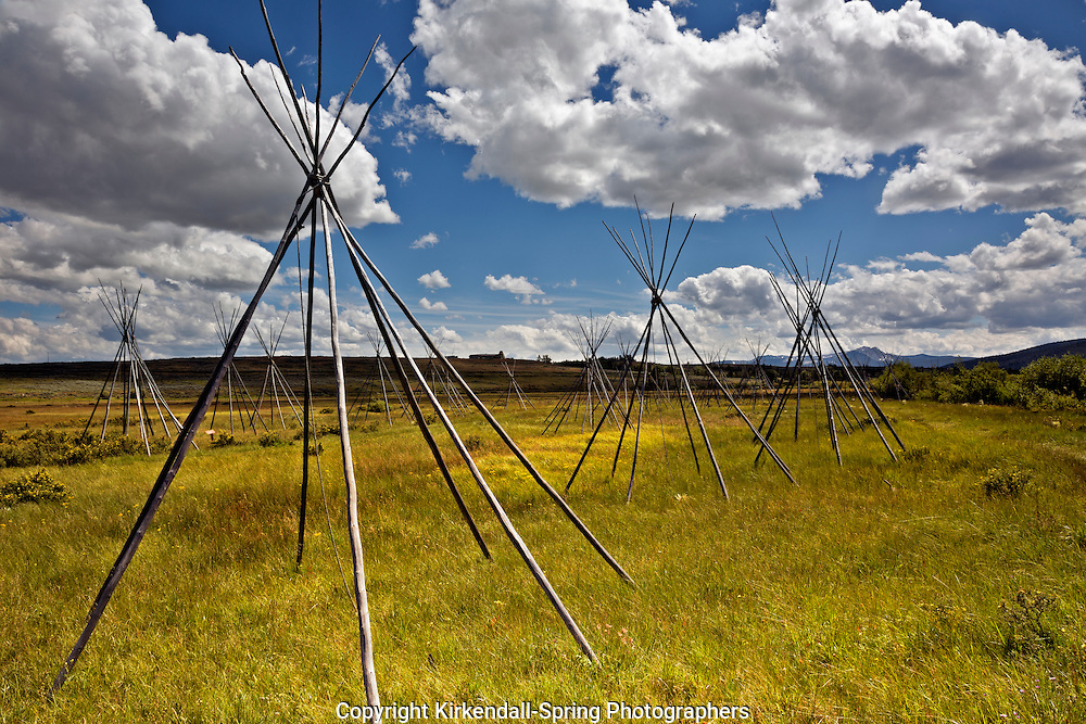 MT00082-00...MONTANA - Ghost teepees, poles standing to mark the location of where people were sleeping the night of the slaughter at the Big Hole National Battlefield. Visitor Center is on the hill overlooking the battlefield.