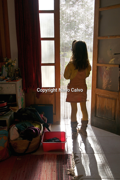 MR Girl standing by the door in her house, Ibiza, Spain