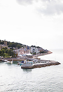 The Royal Yacht Squadron at the entrance to the Medina River in Cowes on the Isle of Wight. The famous club is 200 years old in 2015.<br /> The pontoon in the foreground is Trinity Landing.<br /> Picture date: Monday August 17, 2015.<br /> Photograph by Christopher Ison &copy;<br /> 07544044177<br /> chris@christopherison.com<br /> www.christopherison.com