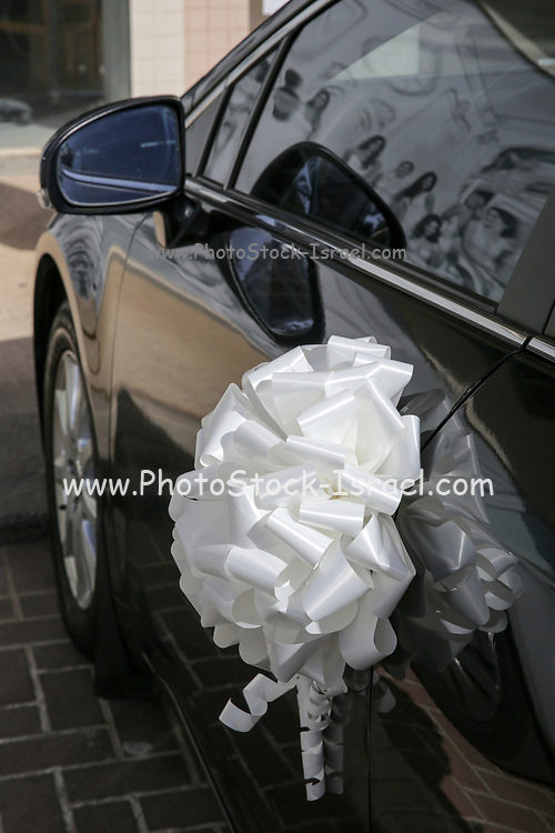 Black Car with bridal decorations