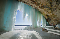 The sun illuminates the beautiful blue ice formations hanging from the cliffs along the Lake Superior shore ~ Michigan's Upper Peninsula