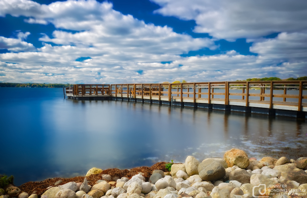 Long exposure on a sunny day at Pewaukee Lake fishing Pier.