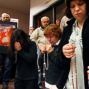 Sarah Murphy, 4, of Kennewick, right, tugs at a rosary in her mouth Monday as her mom Suzie prays alongside Debbie Lord of Kennewick and Lynda DeMortino of Benton City during a meeting in which the Pasco City Council approved the proposed Planned Parenthood to be located at 3901 W. Court St. More than 100 attended the meeting, including several young children who grew restless during the 2 hour meeting.
