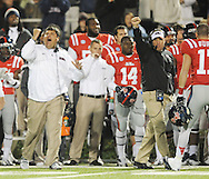Mississippi assistant coach Matt Luke, left, and Mississippi Coach Hugh Freeze celebrate stopping Mississippi State on 4th down at Vaught Hemingway Stadium in Oxford, Miss. on Saturday, November 24, 2012. (AP Photo/Oxford Eagle, Bruce Newman).