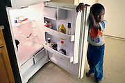 """Travis Gibbs,4, did not choose to be born into poverty. He lives in Frayser, one of the most problematic neighborhoods in Memphis. It has some of the highest rates in foreclosure, crime, infant mortality and it is also home to many of the lowest performing schools. Towards the end of the month there is not much food in the refrigerator, but Travis Gibbs,4, and his teen mother Princess Gibbs, don't eat much and they drink water when they are thirsty. She does not consider herself poor, and she says she is """"less fortunate"""" than others."""