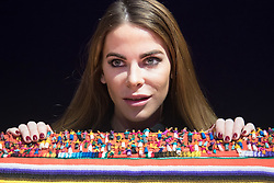 Bonhams, London, February 29th 2016. Made In Chelsea's Victoria Baker-Harber with her chair which features hundreds of Guatemalan &quot;worry dolls&quot; during a photocall for &quot;Sitting Pretty&quot;, featuring unique, hand painted and upholstered chairs made by 30 celebrities and artists, at Bonhams ahead of their auction in support of a leading AIDS charity, CHIVA Africa.<br /> &copy;Paul Davey<br /> FOR LICENCING CONTACT: Paul Davey +44 (0) 7966 016 296 paul@pauldaveycreative.co.uk